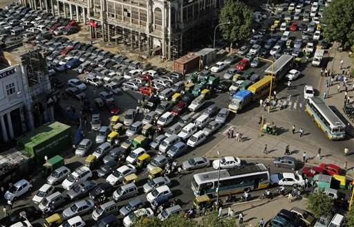 Traffic stands clogged near Connaught Place, a central commercial area, in New Delhi, India, Tuesday, Oct. 6, 2009. A police security drill and rush ahead of the Hindu festival of Karwa Chauth caused the afternoon pile up of traffic in many parts of central Delhi. (AP Photo/Gurinder Osan)